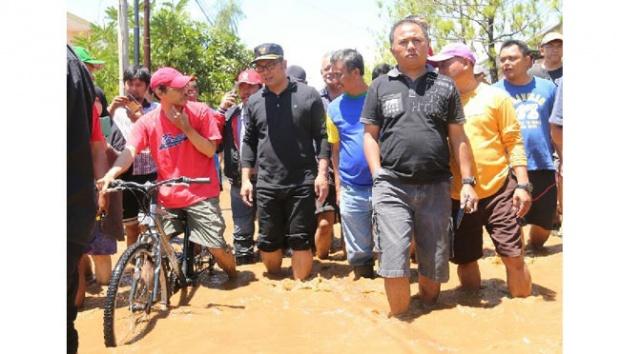 Melalui Twitter Pribadi Walikota Bandung Ridwan Kamil, Meminta Maaf Jalan Pasteur Banjir