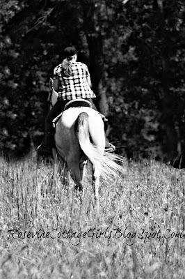 Woman riding a horse in tall grass. | Looking Back | rosevinecottagegirls.com
