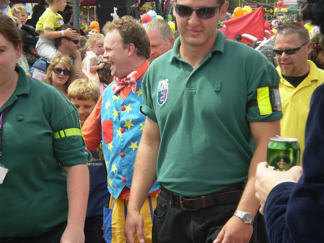 mr tumble surrounded by bouncers at a festival