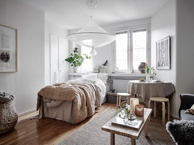 Tonuri neutre de culoare și o amenajare scandinavă într-o garsonieră de 27 m²