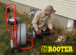 Plumbers in Yakima WA using a drain cleaning machine