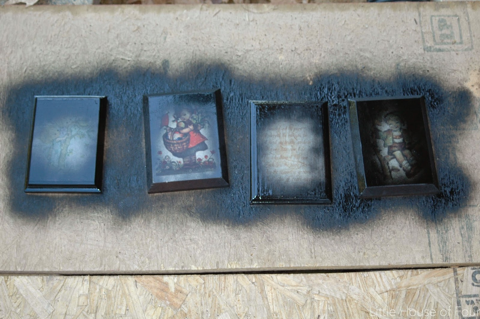 Black spray painted Goodwill plaques
