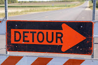 "It's a photo of a ""Detour"" sign."