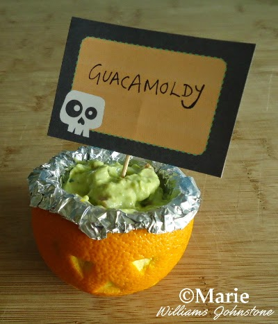 Guacamole dip served up as Guacamoldy in carved orange fruit