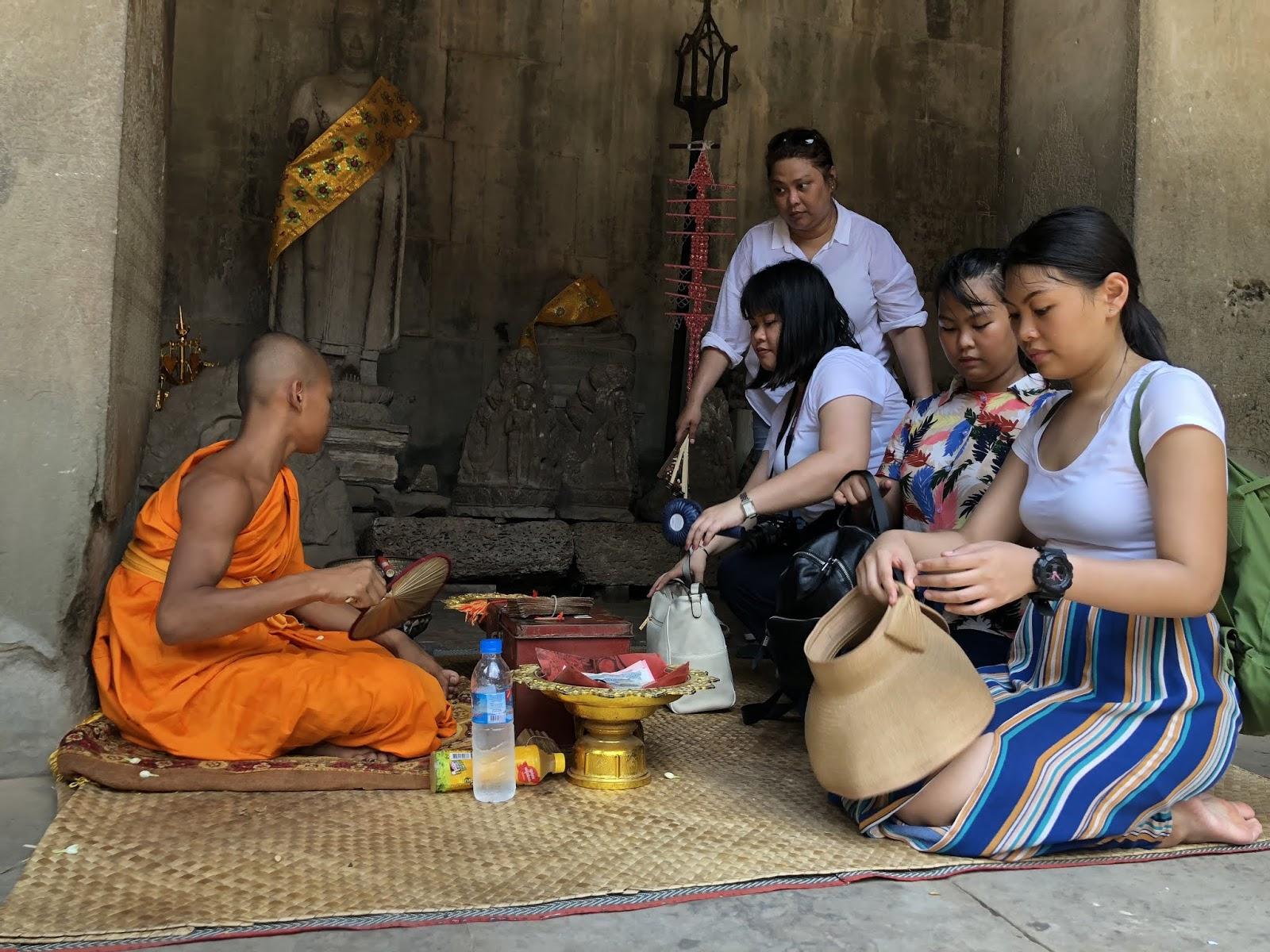 Monk blessing us inside Angkor Wat