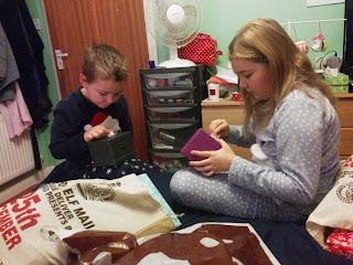 The Children opening their Stocking gifts last Christmas