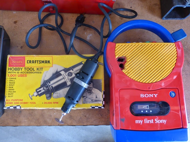 My first sony with botched headphone jack aftermath and Craftsman hobby tool Dremel knock off.