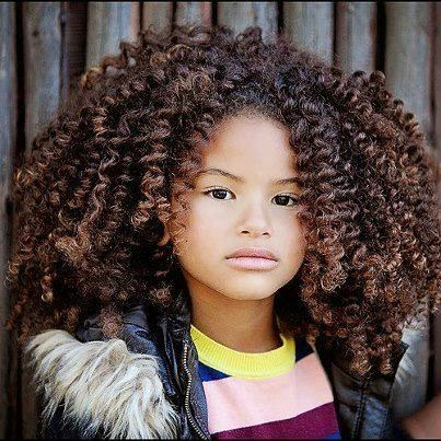This little girl is so cute and has a ton of thick curly hair...glad I don't have to worry about combing it every day.lol natual hair styles for black women | Amazing Curls! | Black Women Natural Hairstyles