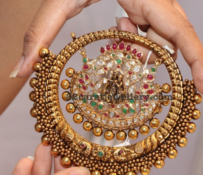 Radha krishna antique pendant jewellery designs antique work dull finish large pendant simple gold swirls embellished across radha krishna pachi work pendant embossed in the center aloadofball Gallery