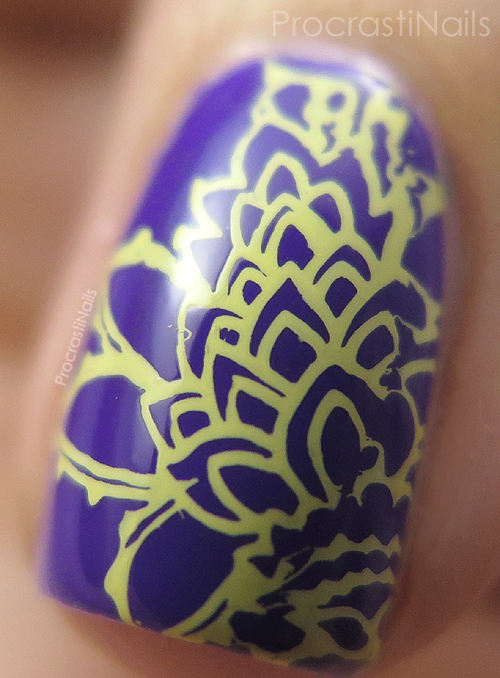 Macro of bold and vibrant purple and pale yellow stamping nail art