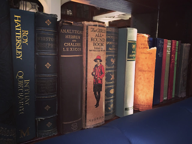 Bookshelf of old books at Cinnamon Club, Westminster