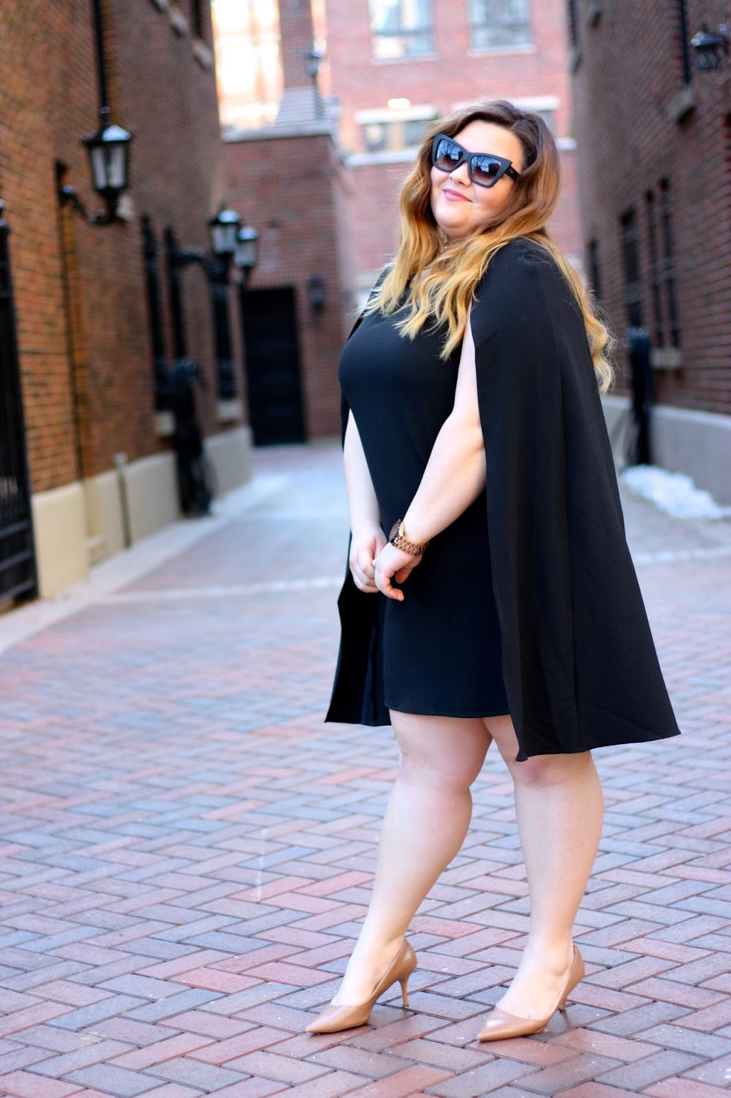 little black dress plus size, LBD, OOTD, natalie craig, cape dress, chicago, natalie in the city, plus size fashion, fashion blogger, forever 21 plus, capes, 2016 fashion trends, why men dont like certain trends, curves and confidence, quay sunglasses blogger, bold sunglasses for my face shape