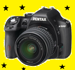 Pentax K500 Review  In the camera world, the Pentax is among the company names that are credited for bringing the SLR camera for the first time. With the 'Pentax K-500', the company is now entering the DSLR camera area. APS-C (23.7x15.7mm) 16 mega pixels CMOS sensor, 100-51200 ISO range, 6 fps drive motor, 11-point AF system, 30 full HD 1080p video recording, 25 and 24 fps, 30 HDR modes of range from 1/6000 to second and shutter speed are special features. View Finder gives around 100 percent range coverage. Apart from this, there is a 3-inch LCD display on the rear side. Distributing two different prices in the camera with some decrease in price, the Pentax has introduced it as a two option (kit) in the market so that it can reach more people in terms of budget and convenience. The first option is Rs. The PaintX coming in price of 29, 995 is DSLR, in which consumers have 18-55mm + camera body. The second option is Rs. 18-55mm + 50-200mm + camera body with the price of 38, 995.    Pentax K500 Design and texture  If you look at the texture, the K500 is more heavier than the other DSLR available on the entry-level market. Although, despite being a plastic body, it looks quite strong, but its weight is 590 grams, compared to the Nikon D-3300 and even Canon 1200 D, which looks strong. Controls, dials and buttons are fitted in the body such that you do not feel confused with them, even if you are a user of Nikon or Canon DSLR, then you do not have much time to use controls. Pentax claims that the K500 is built on the K-50 and despite the entry level camera it does not have 'Weather ceiling feature'.  Dial three has been given - one mode changes, while the other two aperture and shutter are for speed control.    Four-way pad with simple buttons for 3 inch LCD and setting control on the rear side. View Finder with a rubber eyecap has been made very comfortable. The SD card slot is given inside the plastic cover that can be opened on the right. Like other DSLR, it also has 