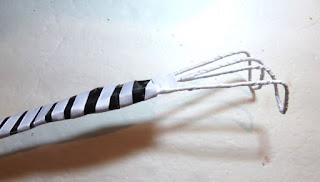 Recycled wire hanger back scratcher