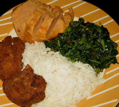 Nigerian vegetable rice served with moi moi and chicken