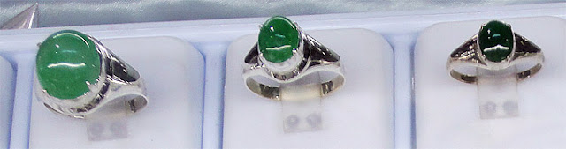 jade rings with cabochons in white gold setting