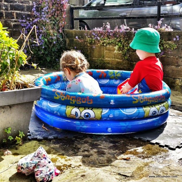Children in paddling pool
