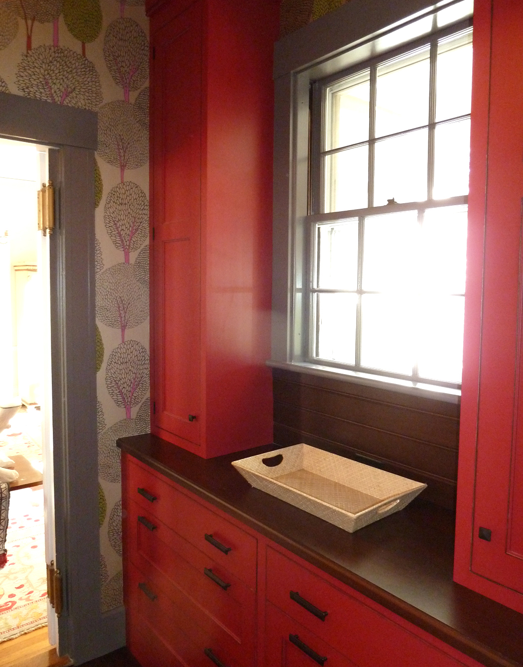 Cherry red cabinets in the butler' s pantry are a happy surprise