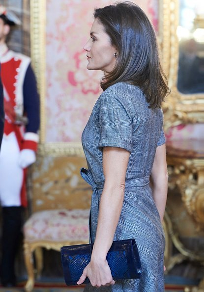 Queen Letizia wore Massimo Dutti wool check dress with belt. She wore Magrit pumps and carried Magrit clutch. Princess Leonor