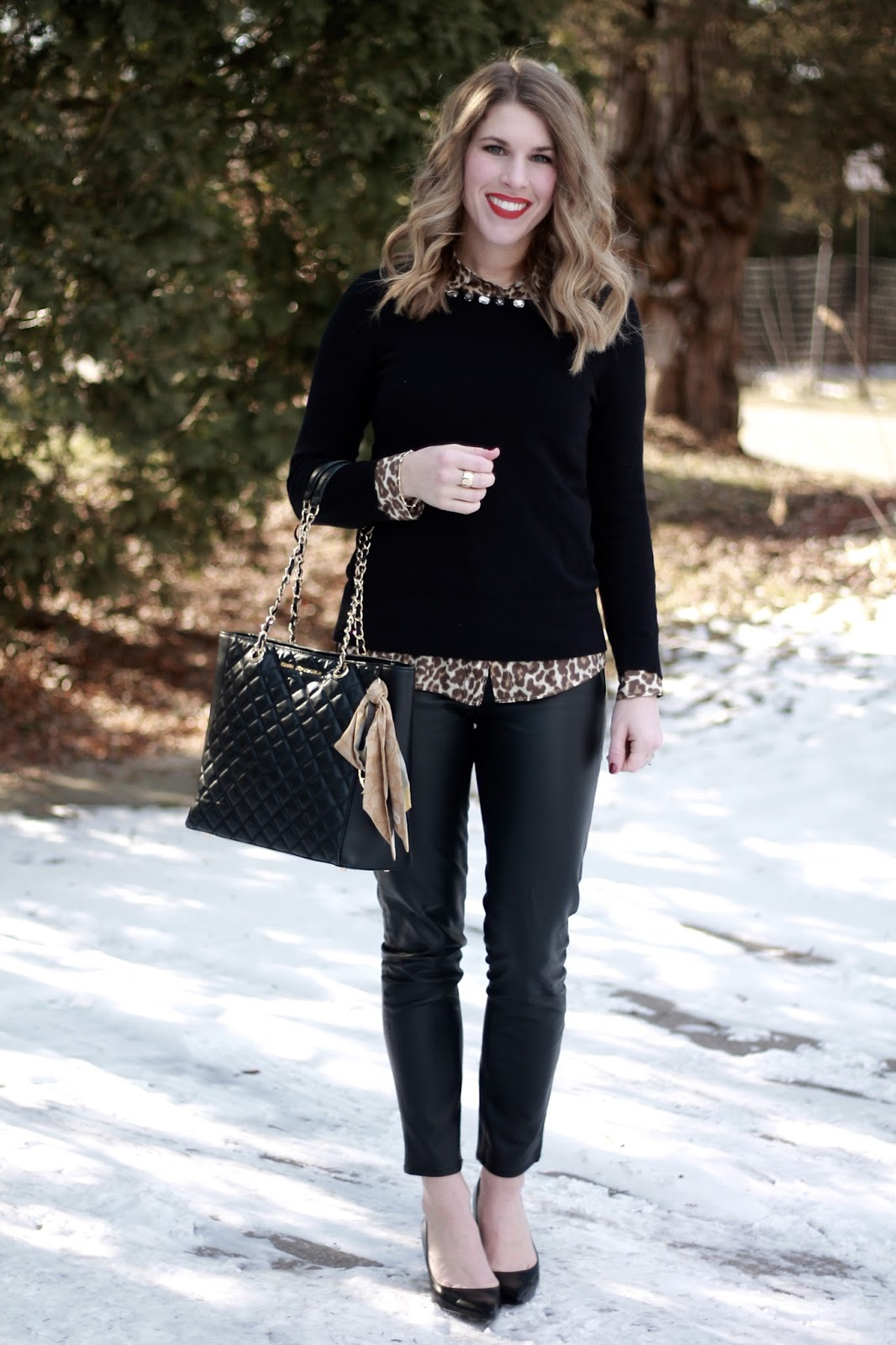leopard button up, black sweater, black leather pants, black heels, black quilted leather tote