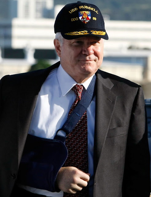 FILE PHOTO: U.S. Defense Secretary Robert Gates wears a USS Russell hat while touring the ship during a stop at Pearl Harbor Naval Base in Honolulu, Hawaii February 21, 2008. REUTERS/Mark Wilson/Pool/File Photo
