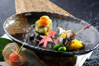 Source: InterContinental Hong Kong. Steamed awabi, uni shijimi dashi jelly and shime saba sashimi kiku dressing.