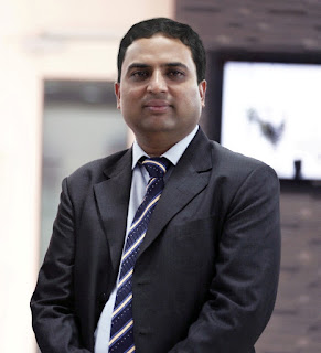 Mr. Kamlesh Patel, Chairman and Managing Director, Asian Granito India Ltd