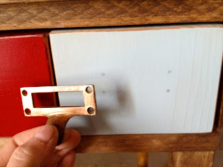 marking the drawer pull screw holes