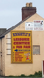 Sign for Knightly's Leisure Centre & Fun Fair in Towyn