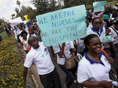 Nurses holding banners in a protest in Nairobi, Kenya June 12, 2017. REUTERS