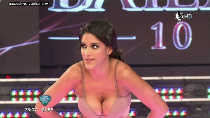 Celeste Muriega bends to show her busty cleavage in lingerie damageinc videos HD