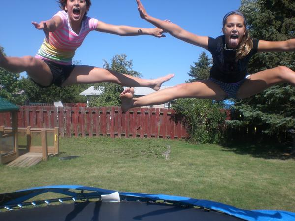 Naked girls jumping on trampolines