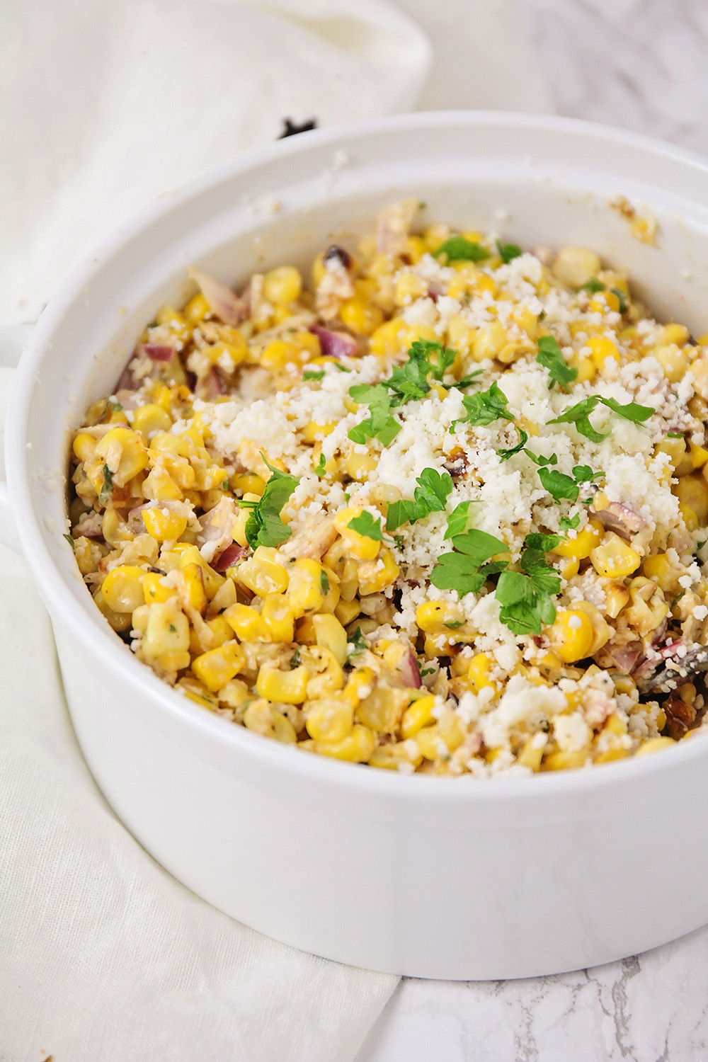 This Mexican street corn salad has the most delicious combination of flavors! It's the perfect accompaniment to taco night!
