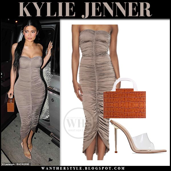 1e1a20a6455 Kylie Jenner in taupe ruched Norma Kamali strapless dress and clear PVC  mules. Night out