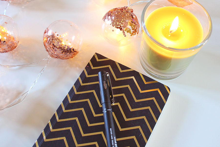notebook desk fairy lights candle