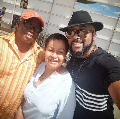 Banky W otherwise called Banky Wellington postured in this charming photograph with his folks . The trio were watching delightful out on a lovely day in Washington DC, USA.