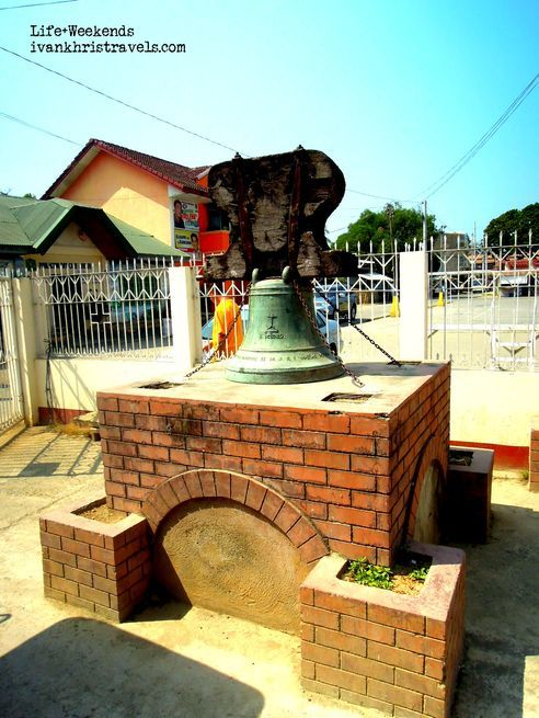 Bell on display in front of San Isidro Labrador Parish Church in Nueva Ecija