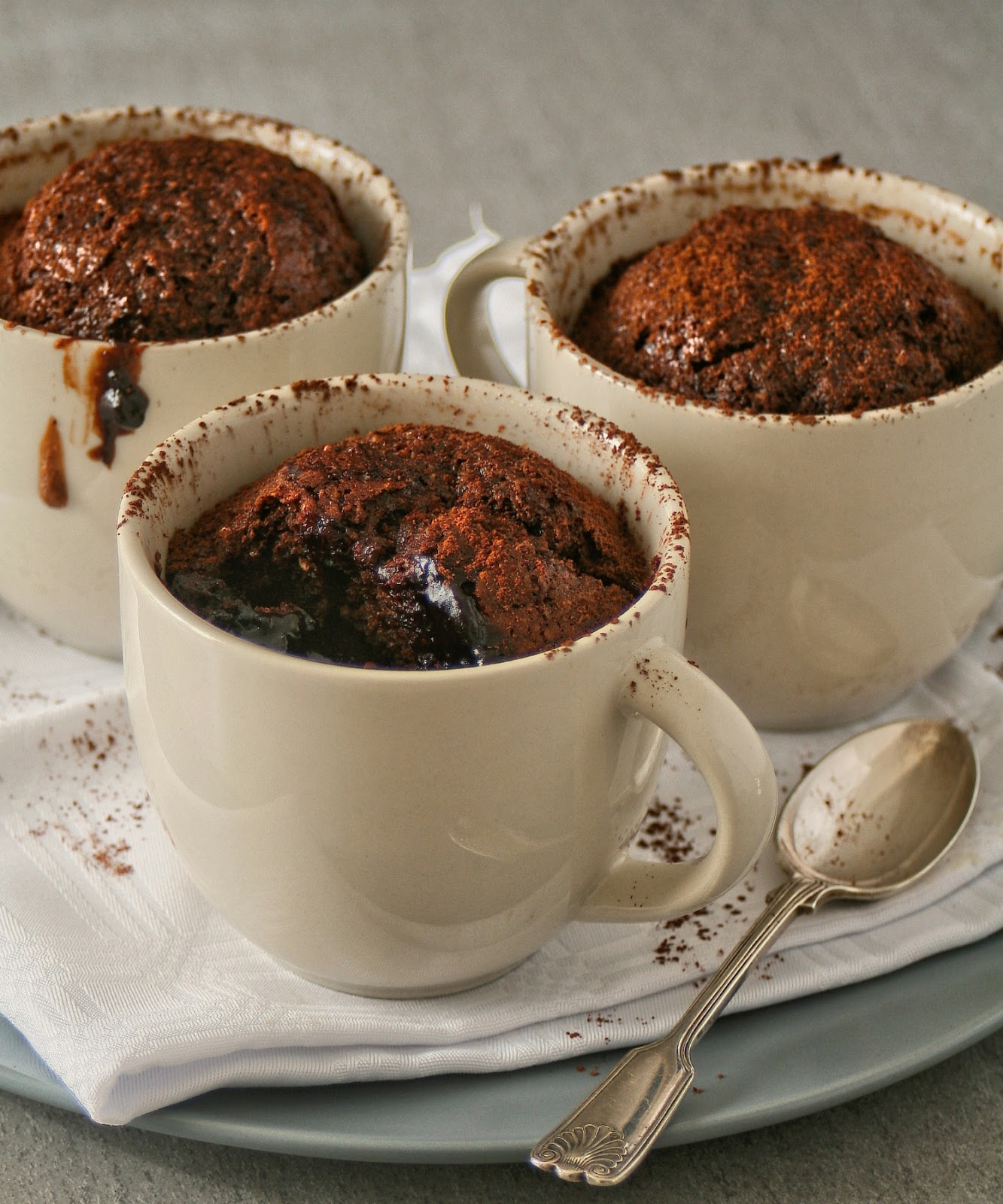 Mini self-saucing chocolate and coconut puddings.