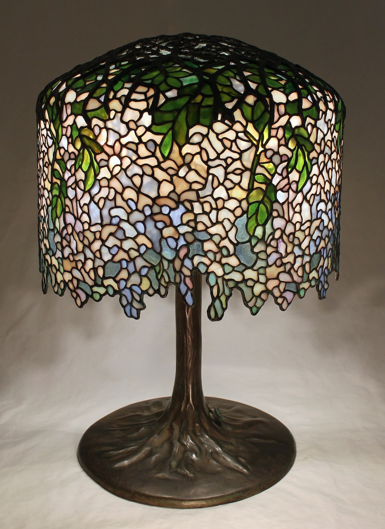 Pair of 18 wisteria lamps completed each shade has close to 2000 individual pieces of hand cut glass and each required close to 300 hours to complete a study tree trunk base supports each mozeypictures Gallery