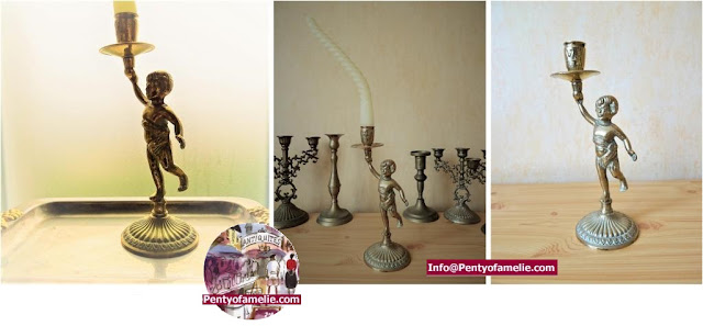 solid Brass Cherub Candlestick with Curled Wax candle, candle holder with golden tone.