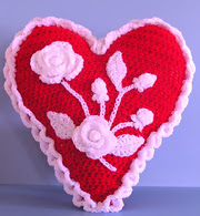 http://www.ravelry.com/patterns/library/hearts-and-flowers-valentine-pillow