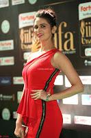 Meenakshi Dixit in Red One Shoulder Red Zipped up gown at IIFA Utsavam Award 71.JPG