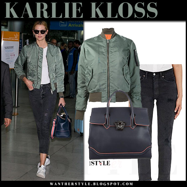 Karlie Kloss in green satin unravel bomber jacket, skinny jeans and white sneakers adidas what she wore streetstyle