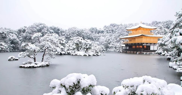 The spiritual Kinkaku-ji pavillon surrounded by greeneries in cold winter months in Kyoto, Japan