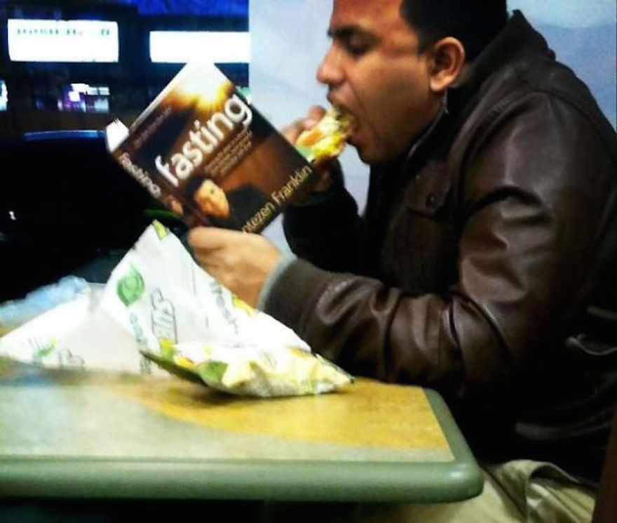17 Hilarious Pictures Of People Reading All The Wrong Books In Public - Clearly He Hasn't Started Fasting Yet, He's Still Trying The 'Jared' Subway Diet