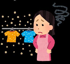 空気の汚れに悩む洗濯物を干す人のイラスト(黄砂・花粉)