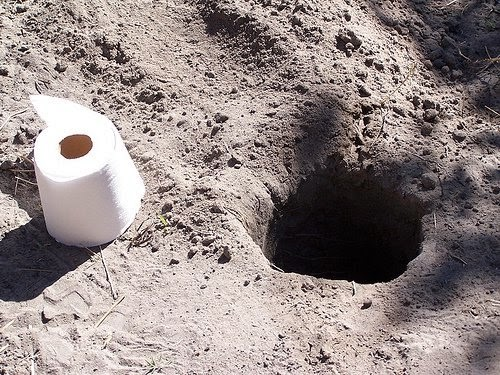 Funny African ground dirt toilet picture