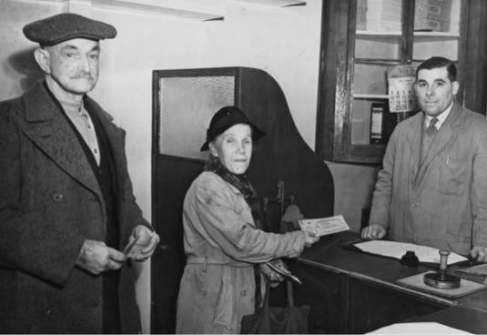Photograph of First customers of the new post office in Dellsome Lane. Mr Speary, Maude Littlechild, Bill Papworth on December 1, 1950. Image from R. Papworth part of the Images of North Mymms collection