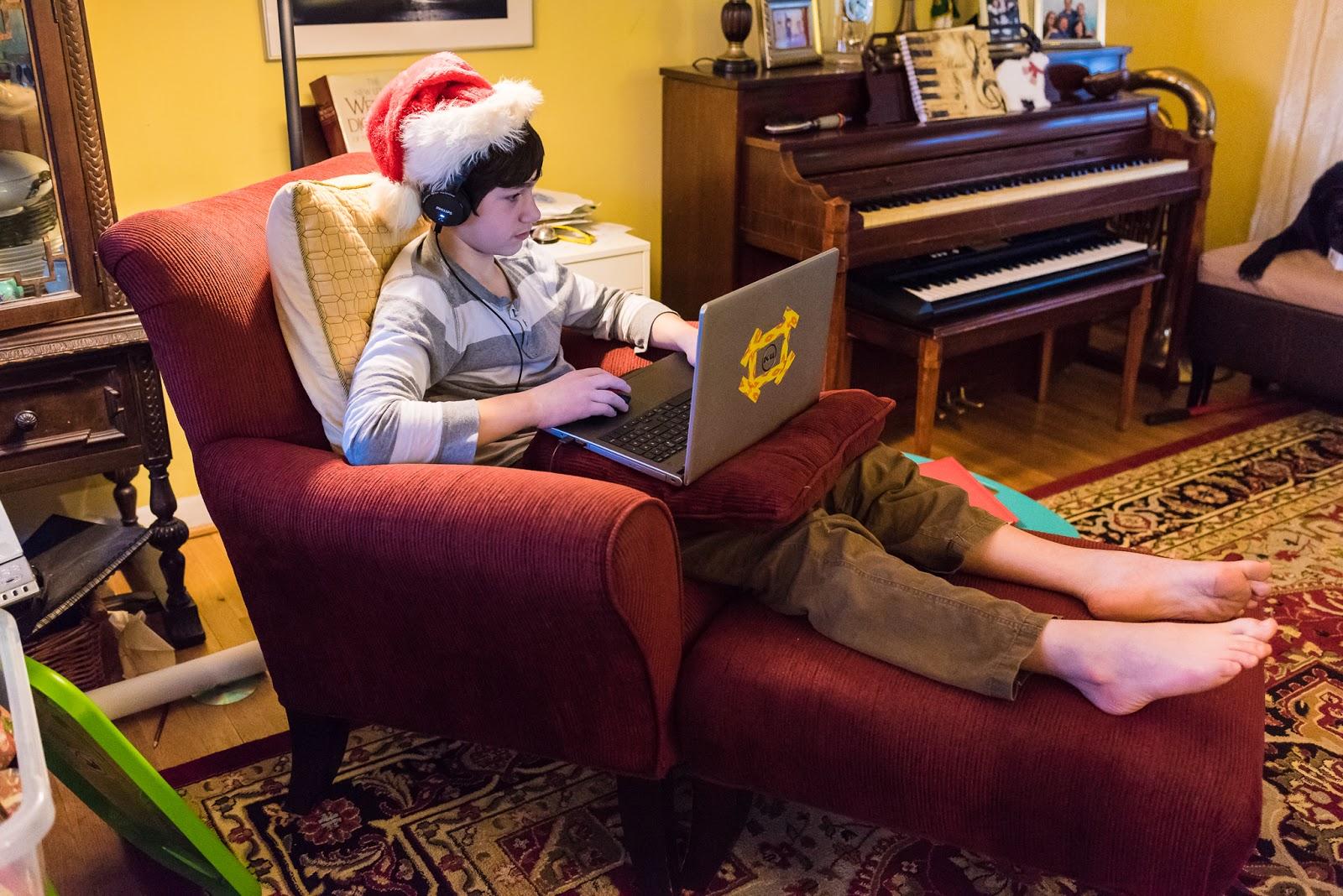 boy in Santa Hat using laptop