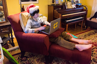 boy in Santa Hat using laptop